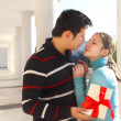 Happy young couple in love with present — Stock Photo #16970941