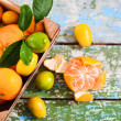 Stock Photo: Fresh citrus fruits in wooden box