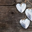 Stock Photo: Metal hearts on wooden background