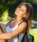 Happy young student outdoors — Stock Photo