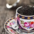 Close up of tea leaves in vintage cup — Stock Photo