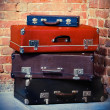 Old vintage suitcases isolated near brick wall — Stock Photo