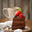 Piece of chocolate cake with icing and fresh berry — Stock Photo