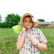 Little boy standing near country house — Stock Photo