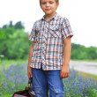 Little boy standing about road — Stock Photo