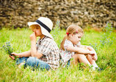Little boy and little girl near the country house — Stock Photo