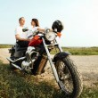 Stock Photo: Young biker couple on the country road