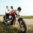 Young biker couple on the country road — Stock Photo