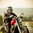 Biker on the country road — Stock Photo #18796751
