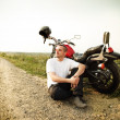 Stock Photo: Biker on country road