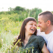 Happy young smiling couple — Stock Photo