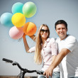 Happy smiling couple with balloons — Stock Photo