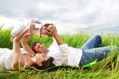 Happy young family with little baby girl — Stock Photo