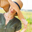 Royalty-Free Stock Photo: Smiling brunette woman in hat