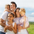 Happy young family with three children — Stock Photo