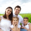 Happy young family with children outdoors — Stock Photo #19499023