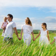 Happy young family with three children — Stock Photo #19499025