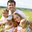 Happy young family with two children — Stock Photo