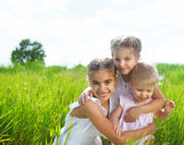 Smiling happy little girls on meadow — Stock Photo