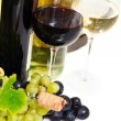 Glasses of white and rose wine and grapes over white — Stock Photo