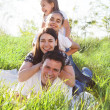 Happy young family with two children — Stock Photo #19997831