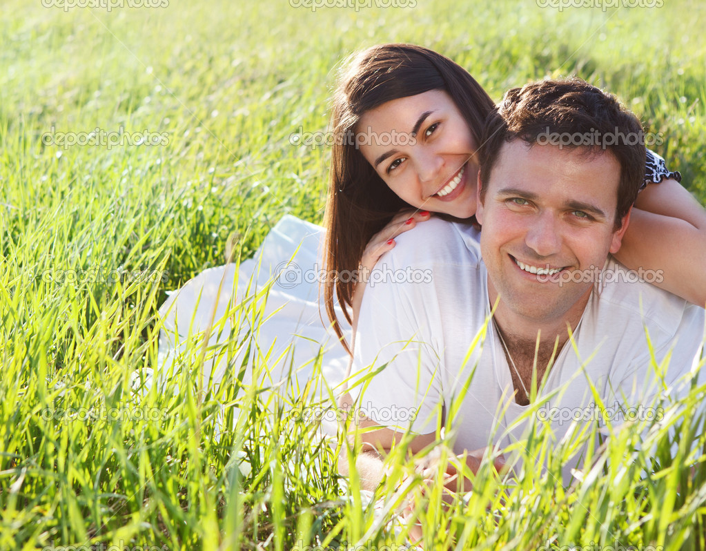 Young happy couple in love in spring day. Outdoors potrait — Stock Photo #19997739