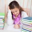 Little girl doing her homework — Foto Stock