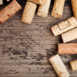 Dated wine bottle corks on the wooden background — Stock Photo #20593073