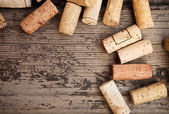 Dated wine bottle corks on the wooden background — Photo