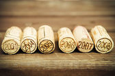 Dated wine bottle corks on the wooden background — Stock Photo