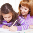 Little girl with and her mother drawing — Stock Photo