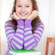 Little brunette smiling girl with books - Stock Photo