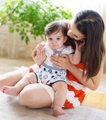 Happy smiling mother with eight month old baby — Stock Photo
