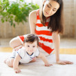 Happy smiling mother with eight month old baby girl — Stock Photo