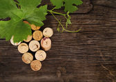 Dated wine bottle corks on the wooden background — Foto de Stock