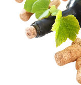 Dated wine bottle corks and bottle — Stock Photo