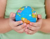 Child holding little globe — Stock Photo
