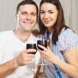 Couple enjoying a glasses of red wine  — Stock Photo