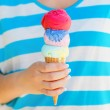 Close up of ice cream cone in woman hand — Stock Photo #22768992