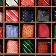 Ties on the shelf of a shop — Stock Photo