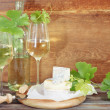 Royalty-Free Stock Photo: Glasses of white wine, bottle and cheese