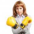 Businesswoman wearing boxing gloves — Stock Photo #23497569