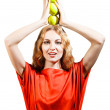 Woman in red holding apples in her hands — Stock Photo