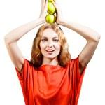 mujer vestida de rojo con manzanas en sus manos — Foto de Stock