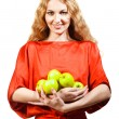 Woman in red holding apples in her hands  — Stock fotografie
