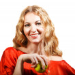 Woman in red holding apple in her hand  — Lizenzfreies Foto