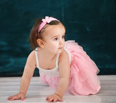Portrait of the one year old baby wearing ballet suit — Stock Photo