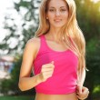 Sport fitness running woman jogging during outdoor workout — Photo