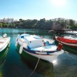 Boats at Voulismeni lake in Agios Nikolaos. Crete — Stock Photo #25501695