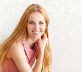 Portrait of happy cheerful smiling young beautiful blond woman — Stock Photo